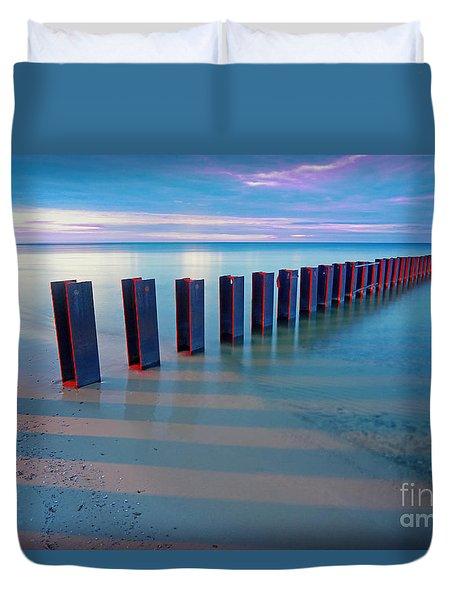 Beach Pylons At Sunset Duvet Cover