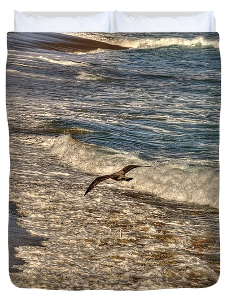 Duvet Cover featuring the pyrography Bird Gliding Over Seashore by Julis Simo