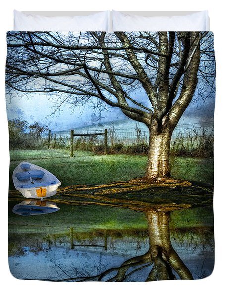 Boat On The Lake Duvet Cover by Debra and Dave Vanderlaan