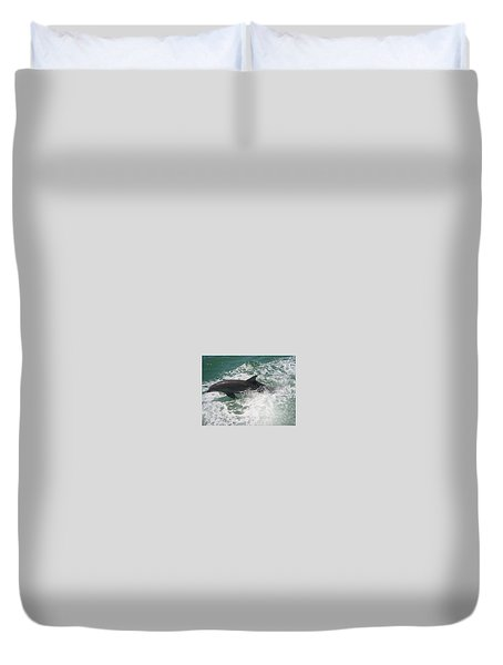Bottlenose Dolphin Catching A Wave Duvet Cover by Jean Marie Maggi