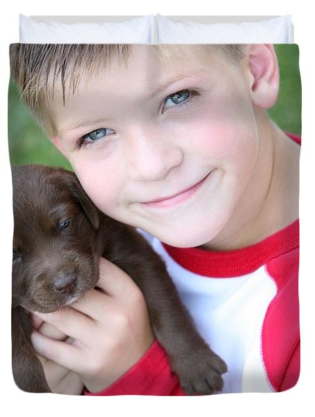 Boy Holding Puppy Duvet Cover by Colleen Cahill