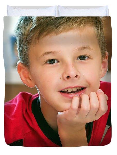Boy Reading Book Portrait Duvet Cover by Michal Bednarek