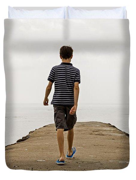 Boy Walking On Concrete Beach Pier Duvet Cover by Edward Fielding