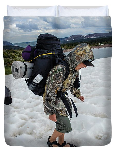Boys Cross A Snowfield Above Five Point Duvet Cover