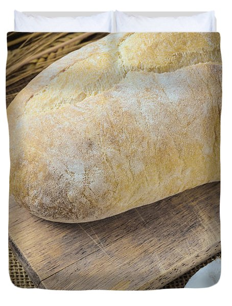 Bread On Bread Board With Wheat And Flour Filled Spoon On Burlap Duvet Cover by Brandon Bourdages