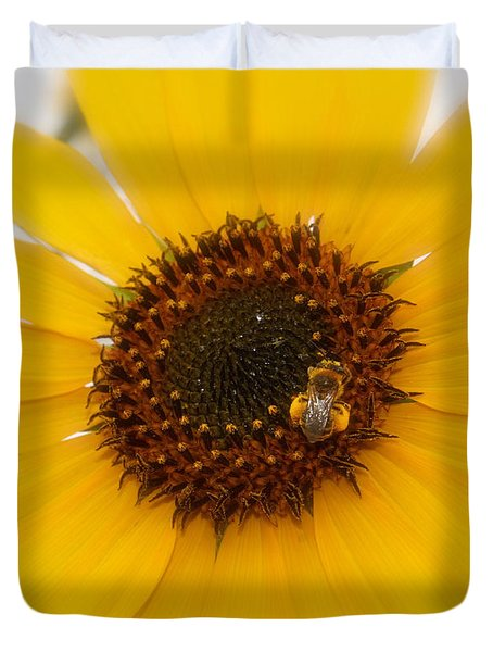 Duvet Cover featuring the photograph Vibrant Bright Yellow Sunflower With Honey Bee  by Jerry Cowart