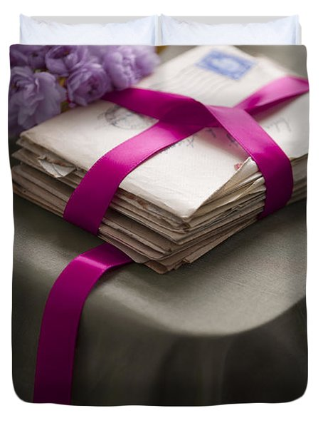 Bundle Of Old Love Letters Tied With Ribbon And Blossom Photograph