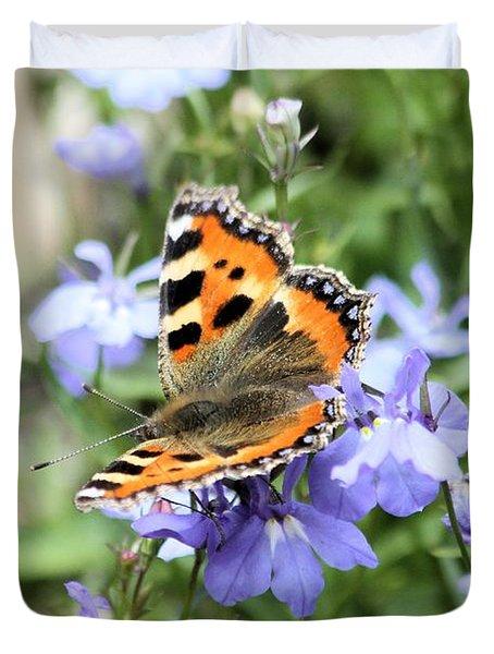 Butterfly On Blue Flower Duvet Cover by Gordon Auld