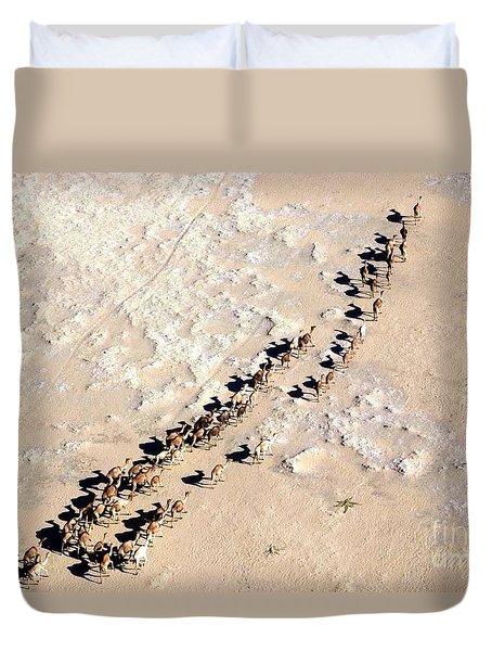 Camels Walking In Desert Duvet Cover