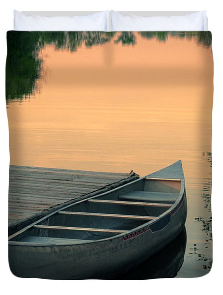Canoe At A Dock At Sunset Duvet Cover by Jill Battaglia