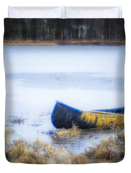 Canoe At The Frozen Lake Duvet Cover