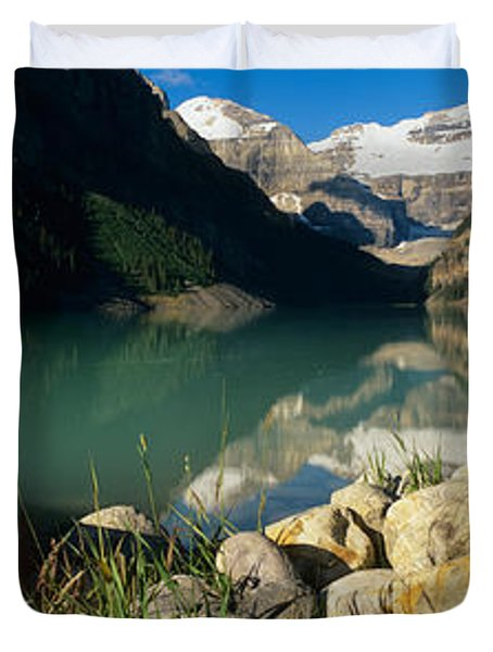 Canoe At The Lakeside, Lake Louise Duvet Cover by Panoramic Images