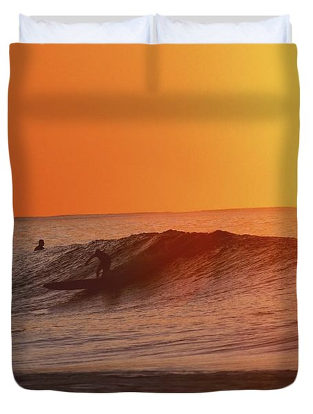 Catching A Wave At Sunset Duvet Cover by Vince Cavataio - Printscapes