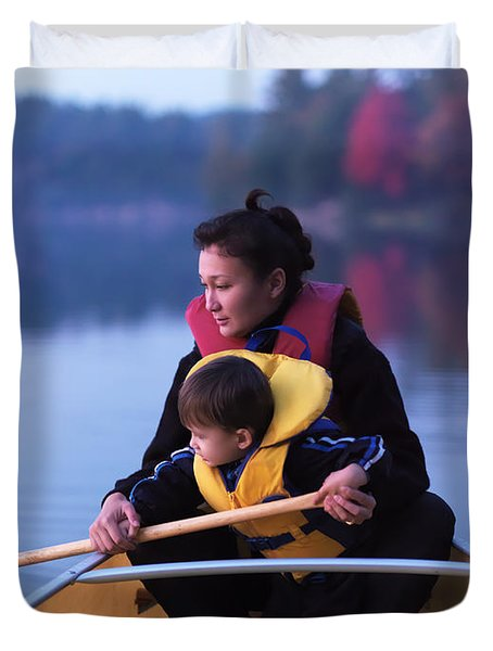 Child Learning To Paddle Canoe Duvet Cover by Oleksiy Maksymenko