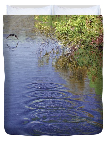 Cormorant Flying Over Lake Creating Concentric Ripples Duvet Cover