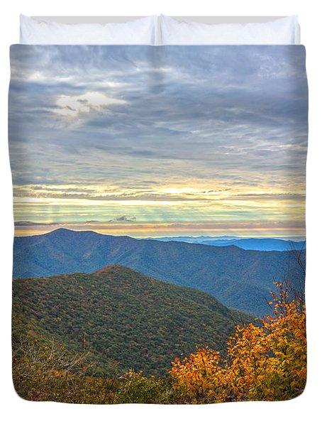 Craggy Sunrise Duvet Cover by John Haldane