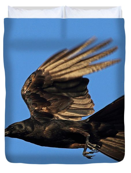 Duvet Cover featuring the photograph Crow In Flight by Meg Rousher