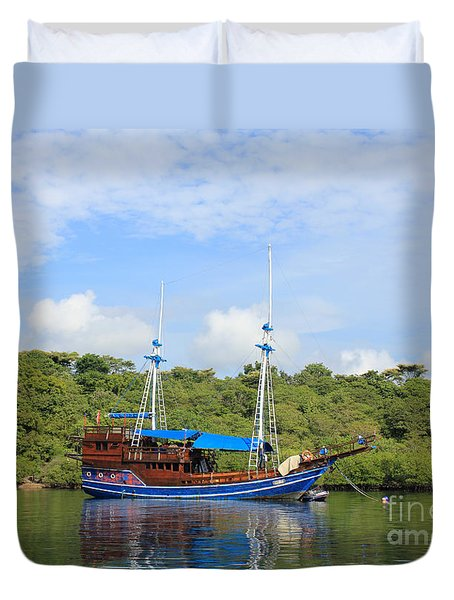Duvet Cover featuring the photograph Cruising Yacht by Sergey Lukashin