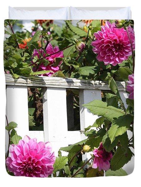 Dahlias Over The Fence Duvet Cover by Carol Groenen