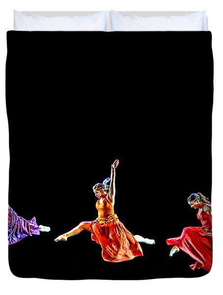 Duvet Cover featuring the photograph Dancers In Flight by Bill Howard