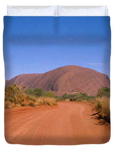 Desert Road And Ayers Rock, Australia Duvet Cover