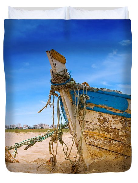 Dilapidated Boat At Ferragudo Beach Algarve Portugal Duvet Cover by Amanda Elwell