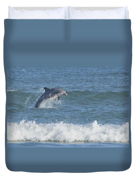 Dolphin In Surf II Duvet Cover by Bradford Martin