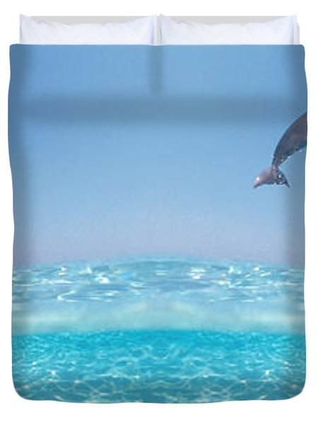 Dolphins Leaping In Air Duvet Cover by Panoramic Images