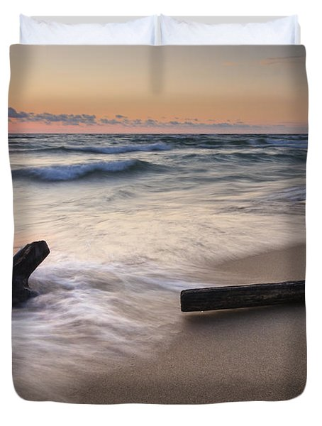 Driftwood On The Beach Duvet Cover by Adam Romanowicz