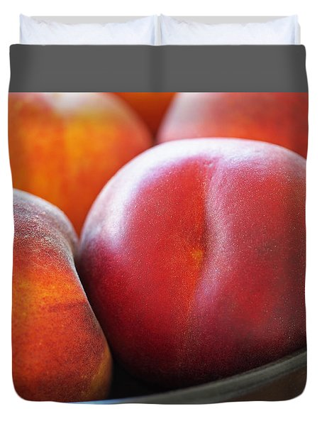 Duvet Cover featuring the photograph Eat A Peach by Rona Black