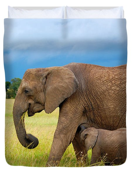 Elephants In Masai Mara Duvet Cover by Charuhas Images