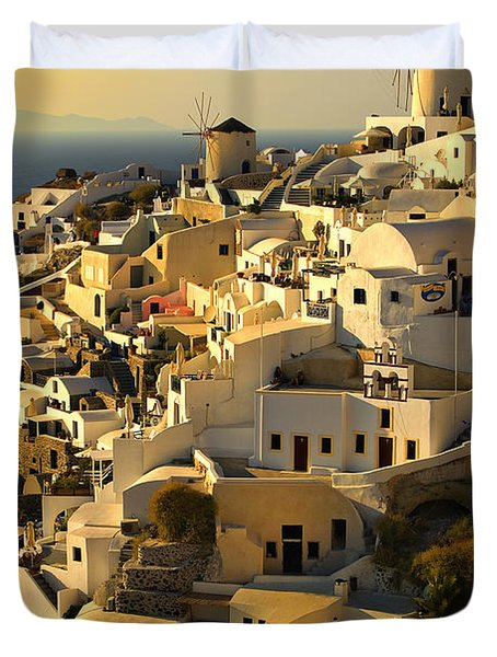 Duvet Cover featuring the photograph evening in Oia by Meirion Matthias