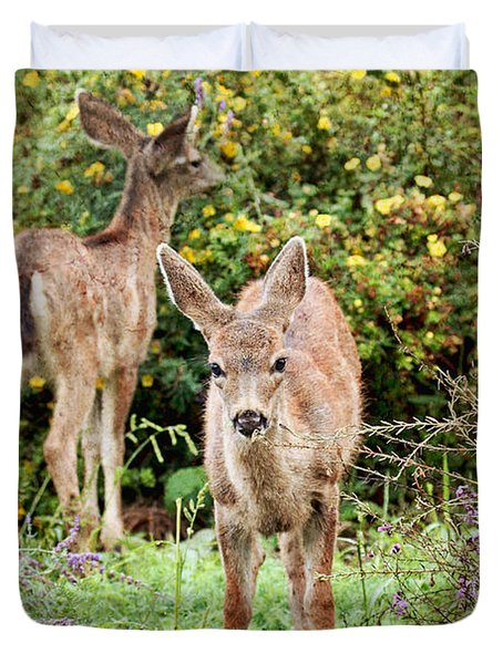 Duvet Cover featuring the photograph Fawns Eating Flowers by Peggy Collins