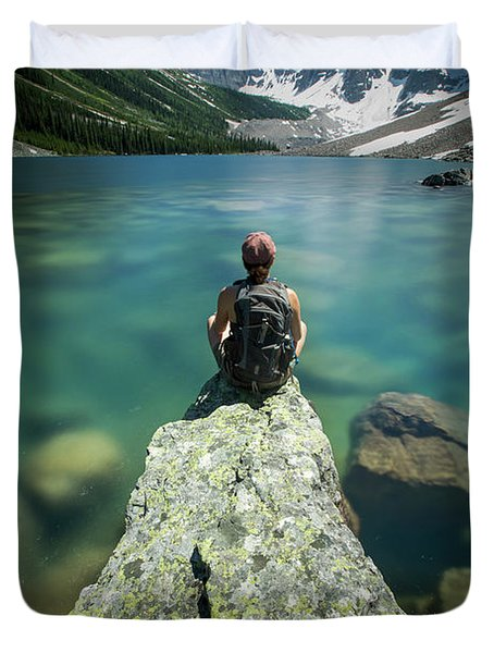 Female Hiker Sitting On Rock On Shore Duvet Cover