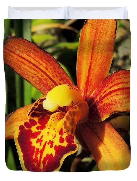 Duvet Cover featuring the photograph Fiery Orchid by Kristine Merc