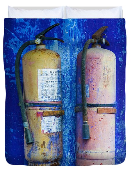 Fire Extinguishers On Blue Temple Wall Duvet Cover