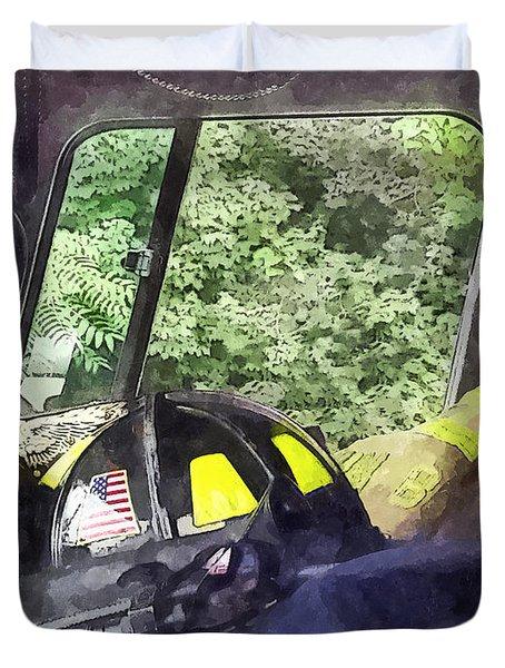 Firemen - Helmet Inside Cab Of Fire Truck Duvet Cover by Susan Savad