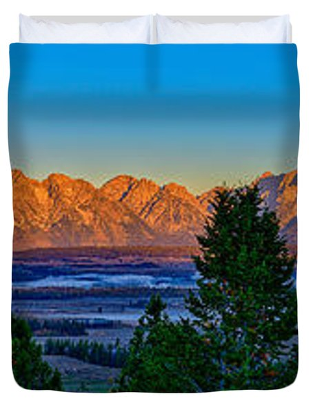 First Light On The Tetons Duvet Cover by Greg Norrell