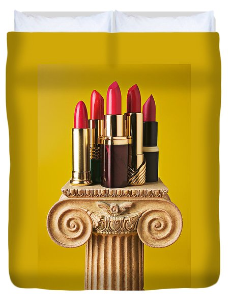 Five Red Lipstick Tubes On Pedestal Duvet Cover by Garry Gay