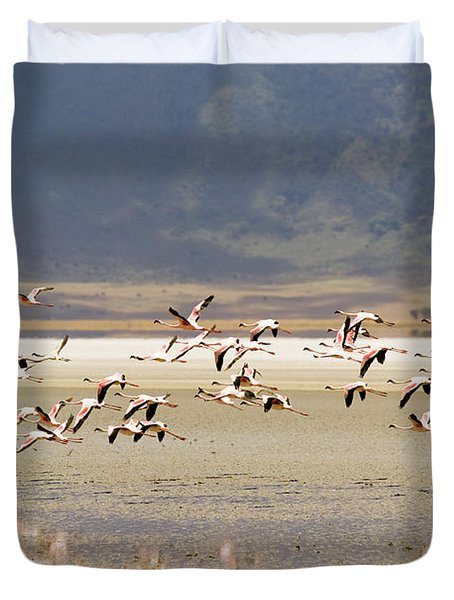 Flamingos Flying Over Water Duvet Cover