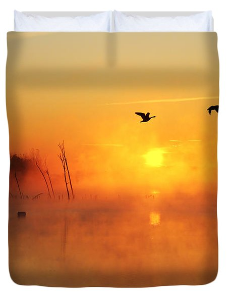 Flight At Sunrise Duvet Cover by Roger Becker
