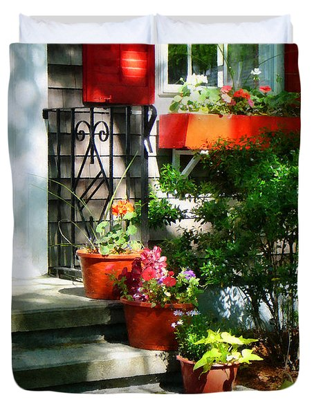Flower Pots And Red Shutters Duvet Cover by Susan Savad