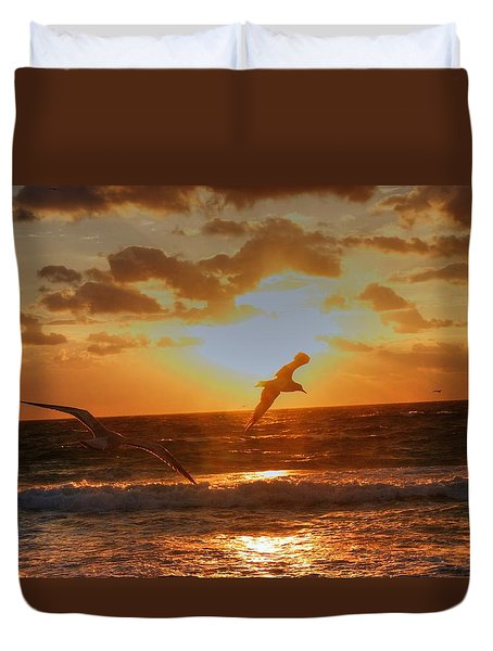 Duvet Cover featuring the photograph Flying In The Sun by Dennis Baswell