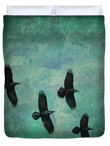 Duvet Cover featuring the photograph Flying Ravens by Peggy Collins