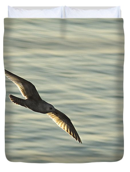 Duvet Cover featuring the photograph Flying Seagull by Yulia Kazansky