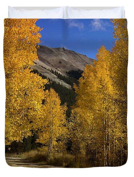 Duvet Cover featuring the photograph Follow The Gold by Ellen Heaverlo
