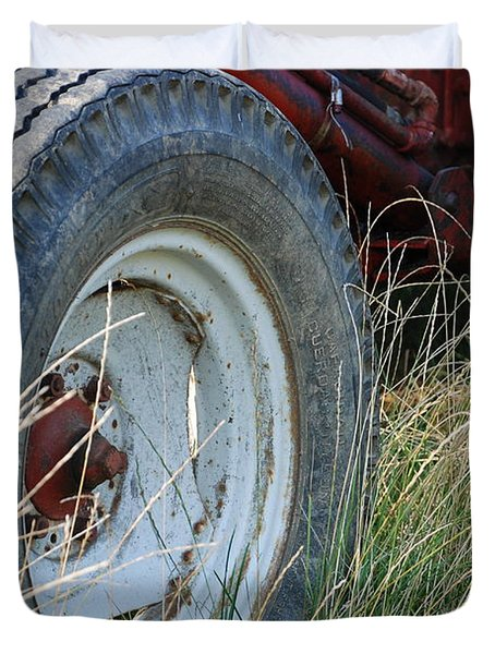 Duvet Cover featuring the photograph Ford Tractor Tire by Jennifer Ancker