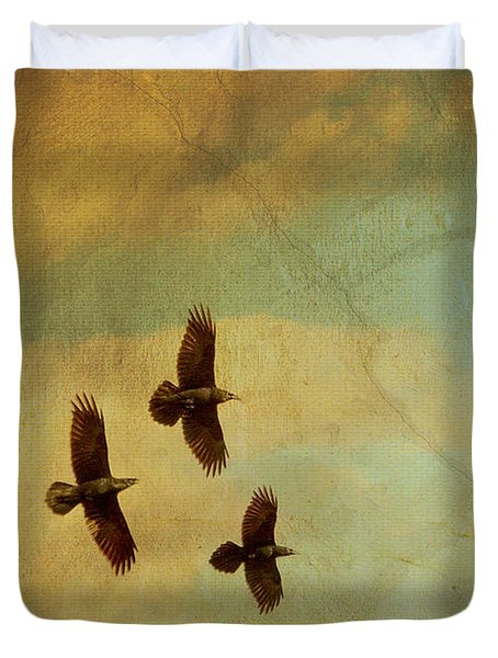 Duvet Cover featuring the photograph Four Ravens Flying by Peggy Collins
