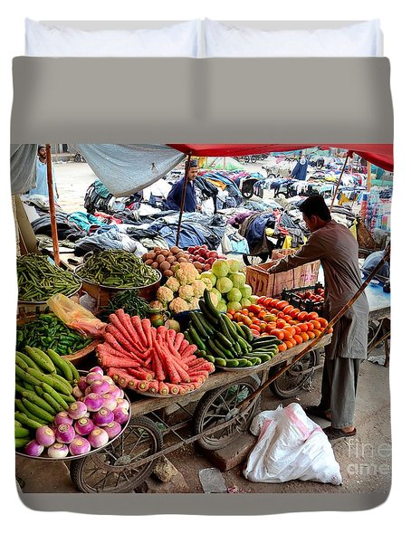Fruit And Vegetable Seller Tends To His Cart Outside Empress Market Karachi Pakistan Duvet Cover