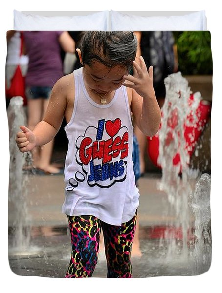 Girl Child Plays With Water At Fountain Singapore Duvet Cover
